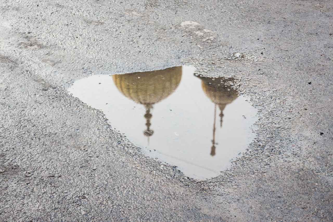 reflection of Sikhs temple dome on street puddle in chandni chowk, old delhi, india Backgrounds Chandnichowk Day Indiapictures No People Olddelhi Outdoors Puddle Puddle Reflections Rain Rainy Day Reflection Standing Water Street Temple Tranquility Water Water Reflections Weather