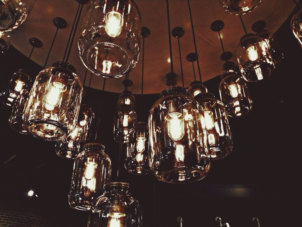 Low Angle View Of Illuminated Pedant Lights Hanging On Ceiling