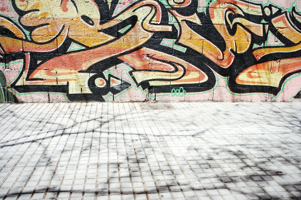 Shadows and graffiti in Tenerife Art And Craft Graffiti Creativity Full Frame Multi Colored Pattern Textured  Backgrounds No People Day Outdoors Close-up Architecture Shadows & Lights Eye4photography  Fresh 3 EyeEm Best Shots Art Is Everywhere Building Exterior Light And Shadow