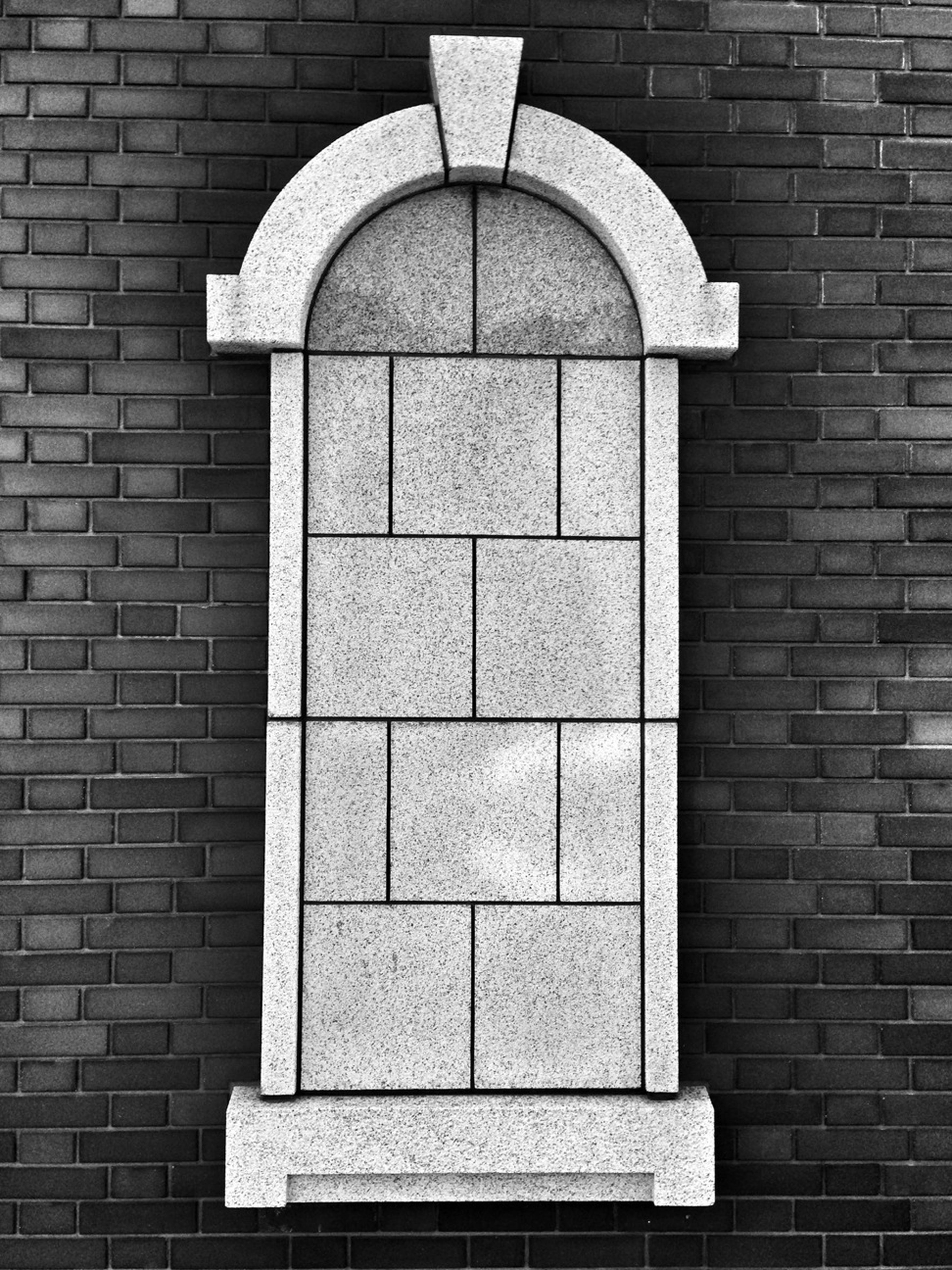 architecture, built structure, building exterior, brick wall, stone wall, arch, wall - building feature, window, brick, history, day, wall, old, outdoors, entrance, facade, no people, low angle view, building, pattern