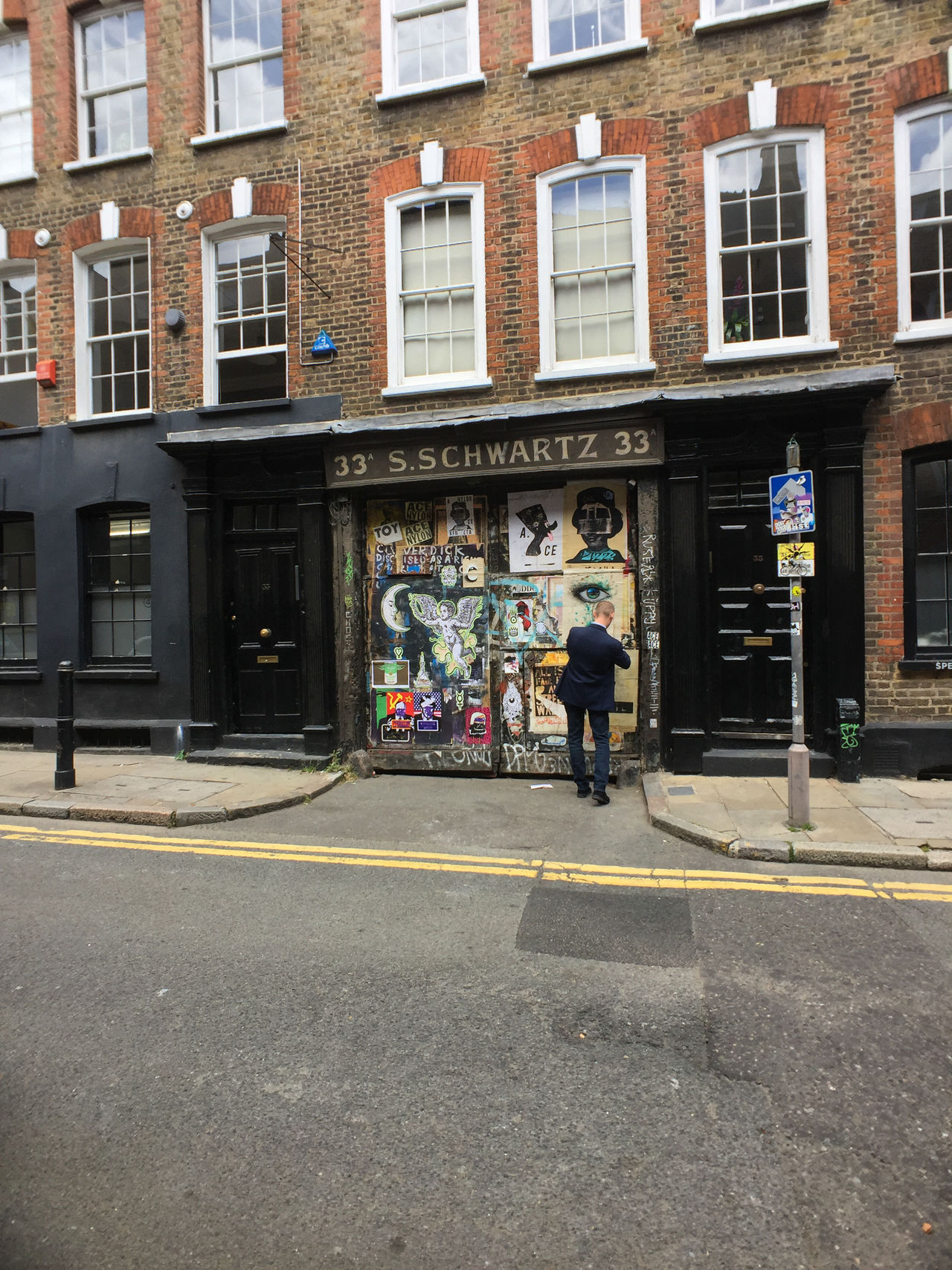 Man taking a photo of a wall of graffiti in London. Graffiti London Adult Architecture Building Exterior Built Structure City Day Editorial  Full Length Graffiti Art Graffiti Wall Men One Person Outdoors People Real People Street Photography Streetphotography Window