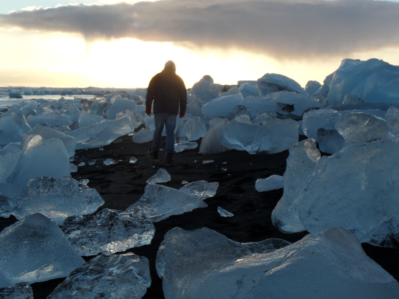 Lost in ice world 🚶 Adventure Beauty In Nature Black Sand Cold Temperature Dramatic Sky Nature Frozen Full Length Ice Ice Blocks Iceland_collection Jökulsárlón Landscape Lost Lost In The Ice World Mountain Nature Only Men Outdoors Real People Rear View Rock - Object Scenics Vatnajökull Warm Clothing Way Out