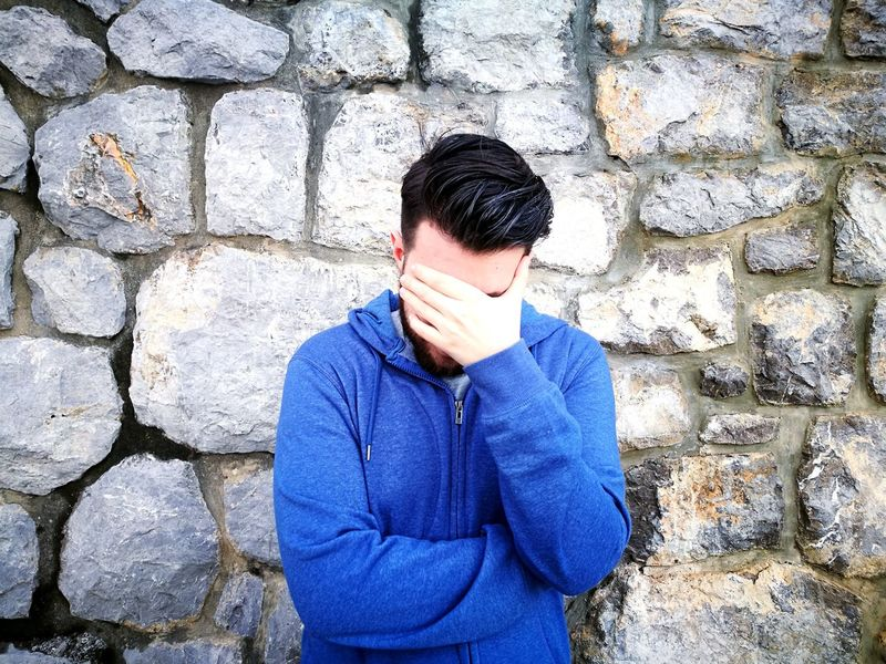 he was a little bit embarrassed at the time but still smiling behind the hand. :) One Person Real People Standing Only Men One Man Only Outdoors Front View Day Adults Only Men People Adult Seaside Blue Stone Wall Close-up HuaweiP9 Young Adult Adult Sunny Human Body Part Haircut Embarrassment Shy
