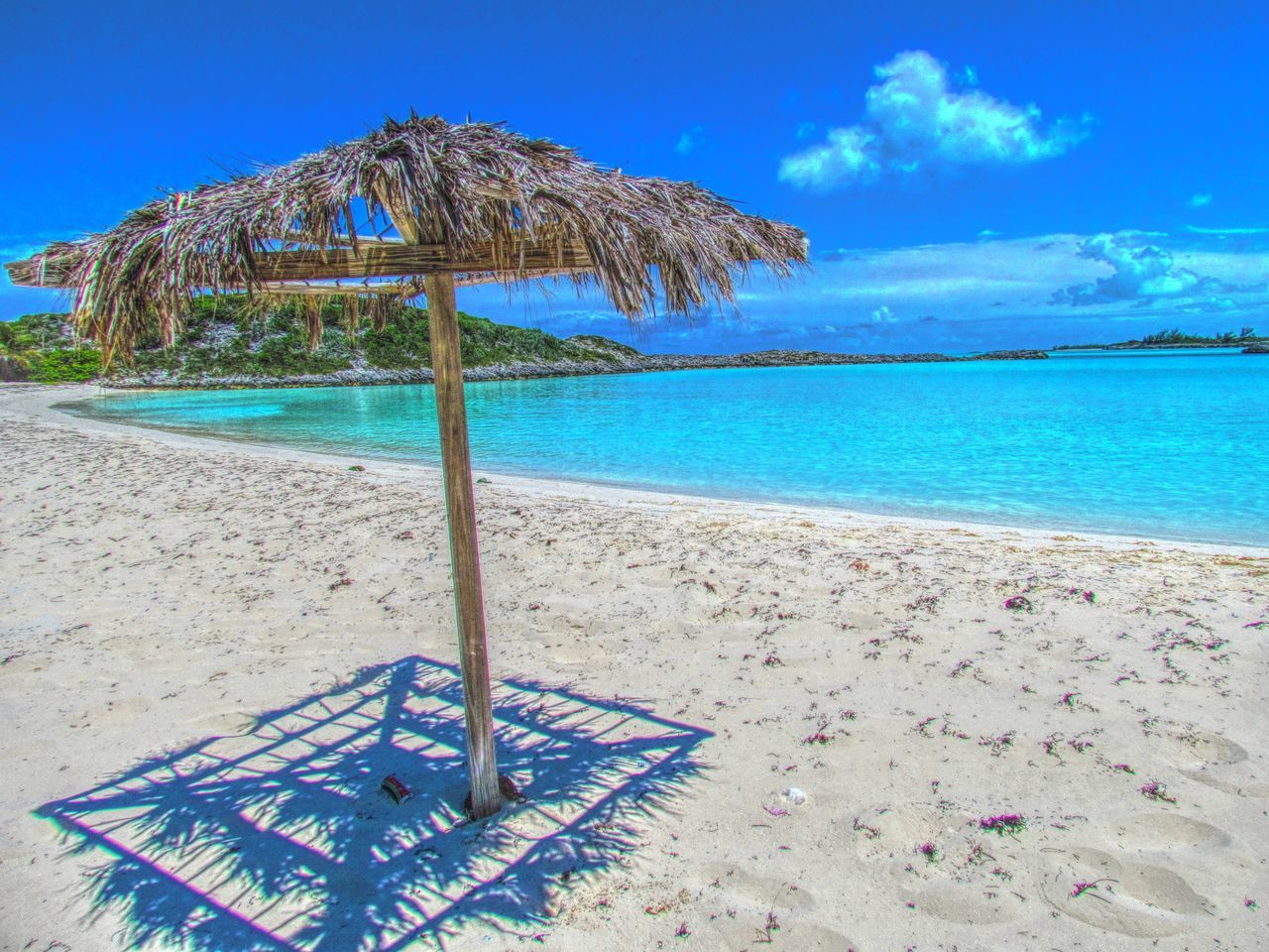 beach, sea, sand, thatched roof, tranquility, tranquil scene, blue, beauty in nature, water, nature, idyllic, scenics, horizon over water, sky, day, summer, outdoors, vacations, no people, shelter, clear sky