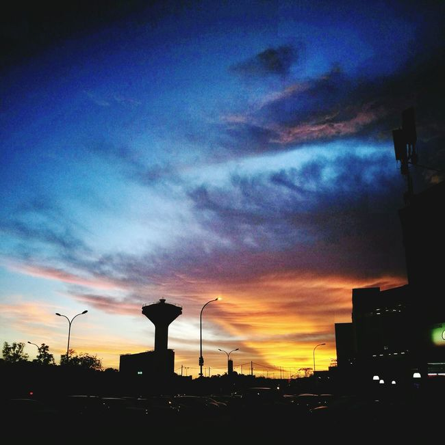 Sunset Architecture Building Exterior Built Structure Silhouette Orange Color Sky City Illuminated Cloud - Sky Scenics Cloud Outdoors Outline Moody Sky Nature City Life Beauty In Nature Tall - High No People