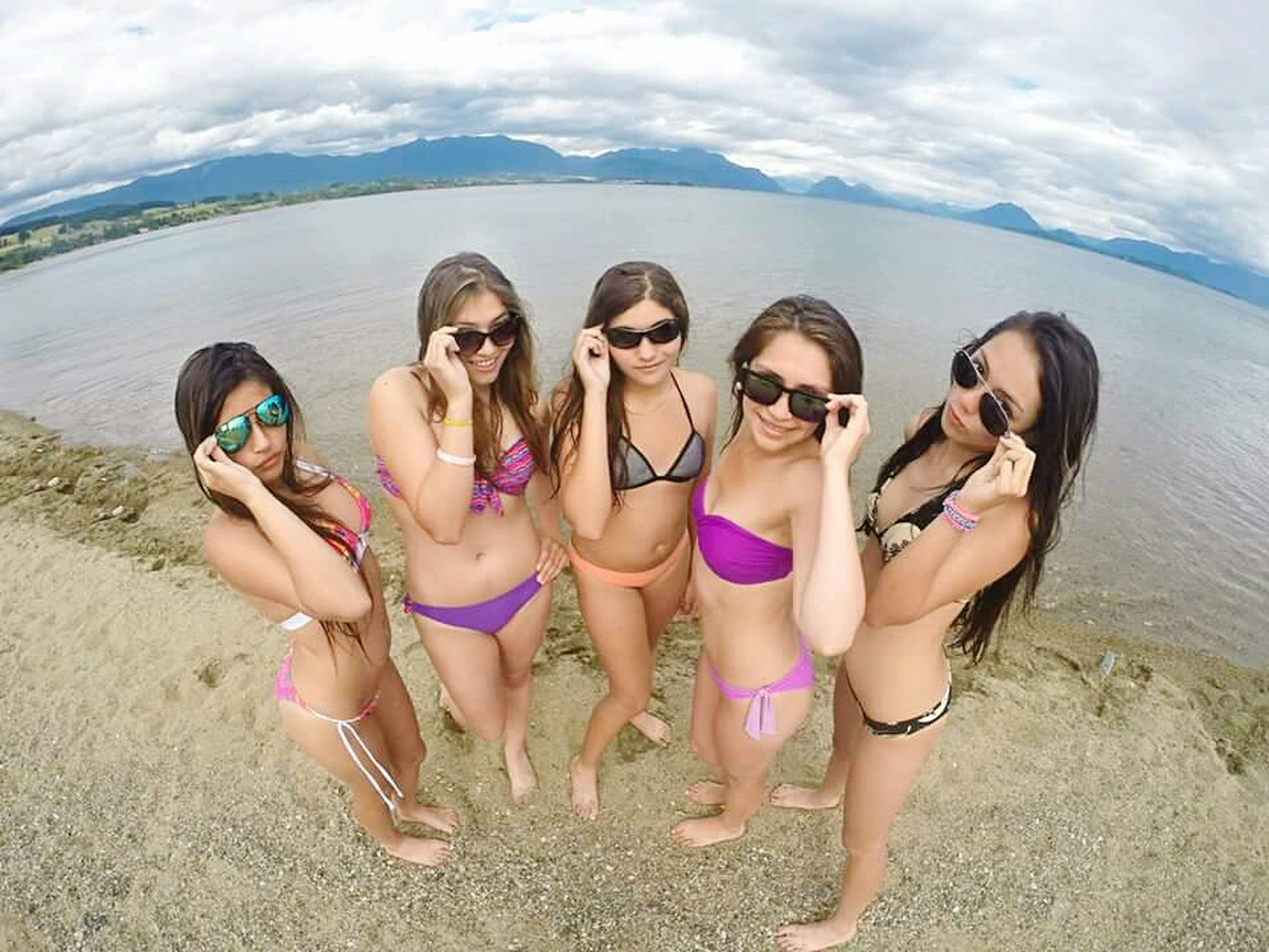 lifestyles, leisure activity, togetherness, young women, young adult, beach, bonding, water, vacations, person, friendship, casual clothing, love, sea, sky, enjoyment, happiness