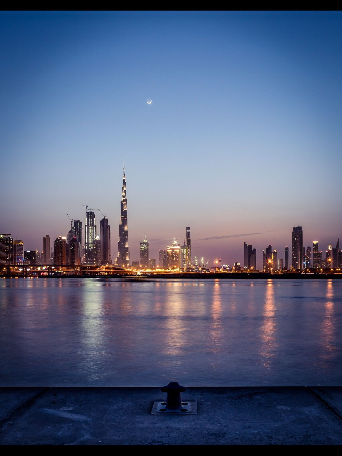Sunset on Downtown Dubai, United Arab Emirates Architecture Building Exterior Built Structure Skyscraper City Tower Night Travel Destinations Cityscape Illuminated Urban Skyline Modern Sky Water River Clear Sky Outdoors Moon Tall No People