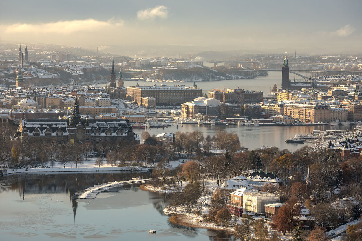 Stockholm, Sweden - Nov 10, 2016 : Aerial view of Stockholm city center during the winter, including the Stockholm City Hall, Royal Palace, Parliament House and the Nordic Museum. This photo was taken after Stockholm had its snowiest November day in 111 years. Aerial View Architecture City City Hall Cityscape Fog Mist No People Nordic Countries Nordic Museum Parliament Building Royal Palace Scandinavia Season  Snow Stockholm Stockholm, Sweden Sweden Travel Travel Destinations Winter