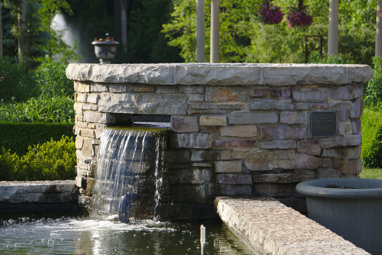 water, waterfall, outdoors, day, tree, motion, nature, no people, built structure, drinking fountain, architecture, scenics, building exterior, beauty in nature