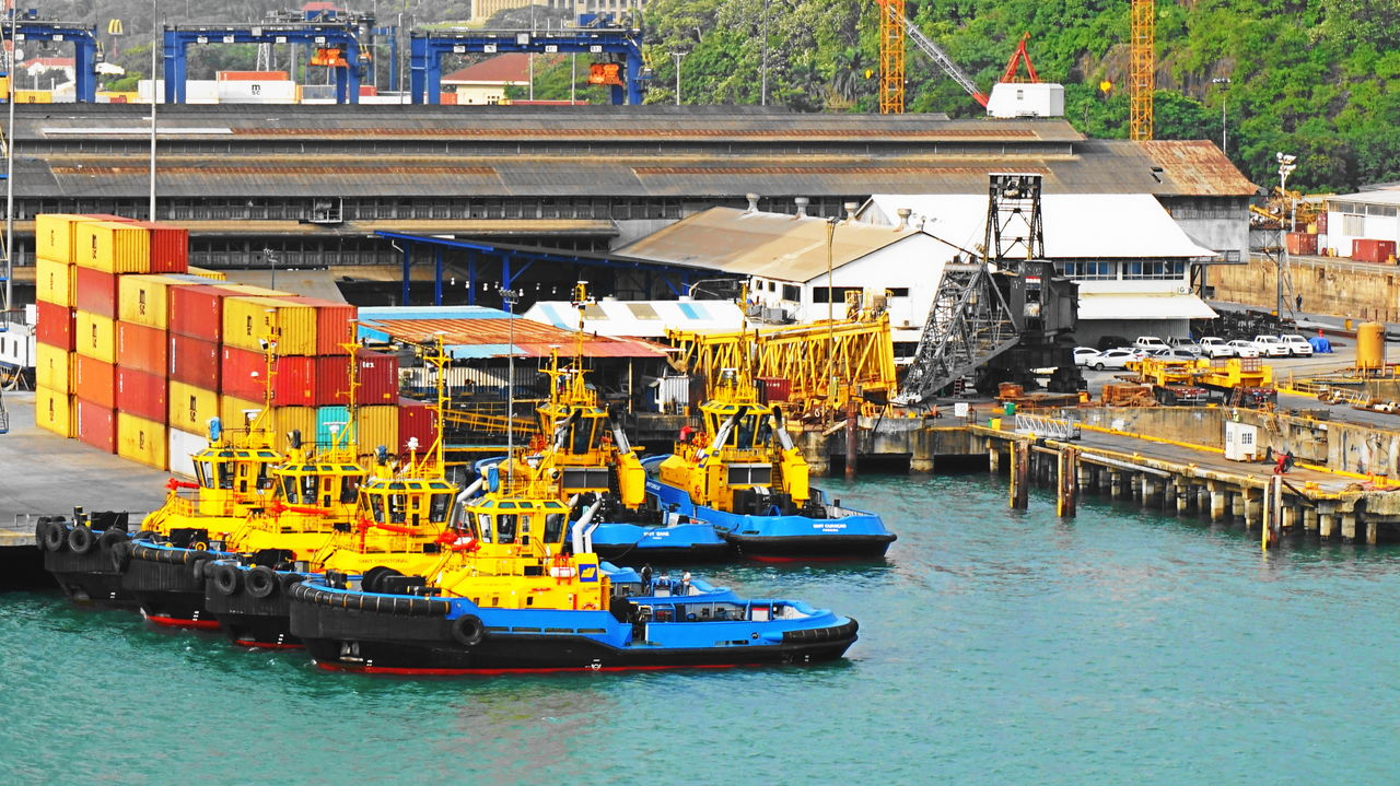 water, transportation, waterfront, freight transportation, moored, mode of transport, nautical vessel, day, industry, crane - construction machinery, machinery, outdoors, shipping, built structure, architecture, construction machinery, commercial dock, harbor, no people, cargo container, building exterior, sea, nature