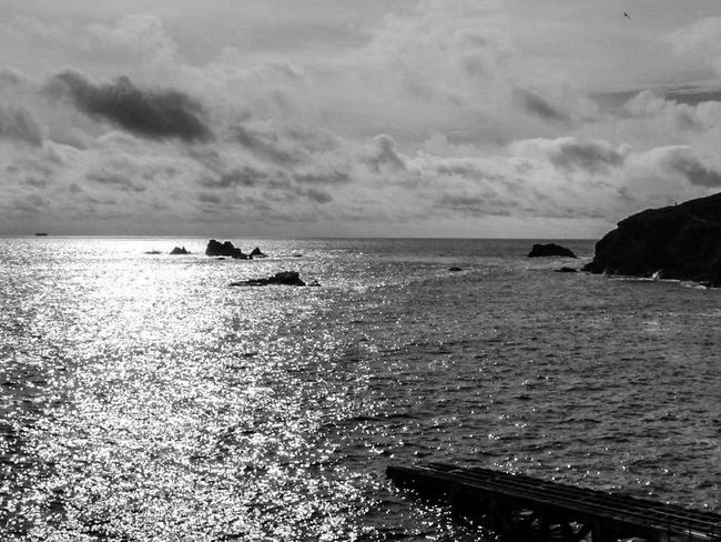 on the greyest of days theres still a glimmer of hope Contrasts Of Beauty Ladyphotographerofthemonth Sea View Nature Water Ocean EyeEm Nature Lover Summertime Beauty In Nature Seascape Cornwall Uk No People AMPt_community For My Friends That Connect Beauty In Everything Cornwall Cliffs And Sea Cliffs And Water Rocks And Water Black And White Monochrome Sea And Sky Lifeboat Station... Sparkling Water Sky