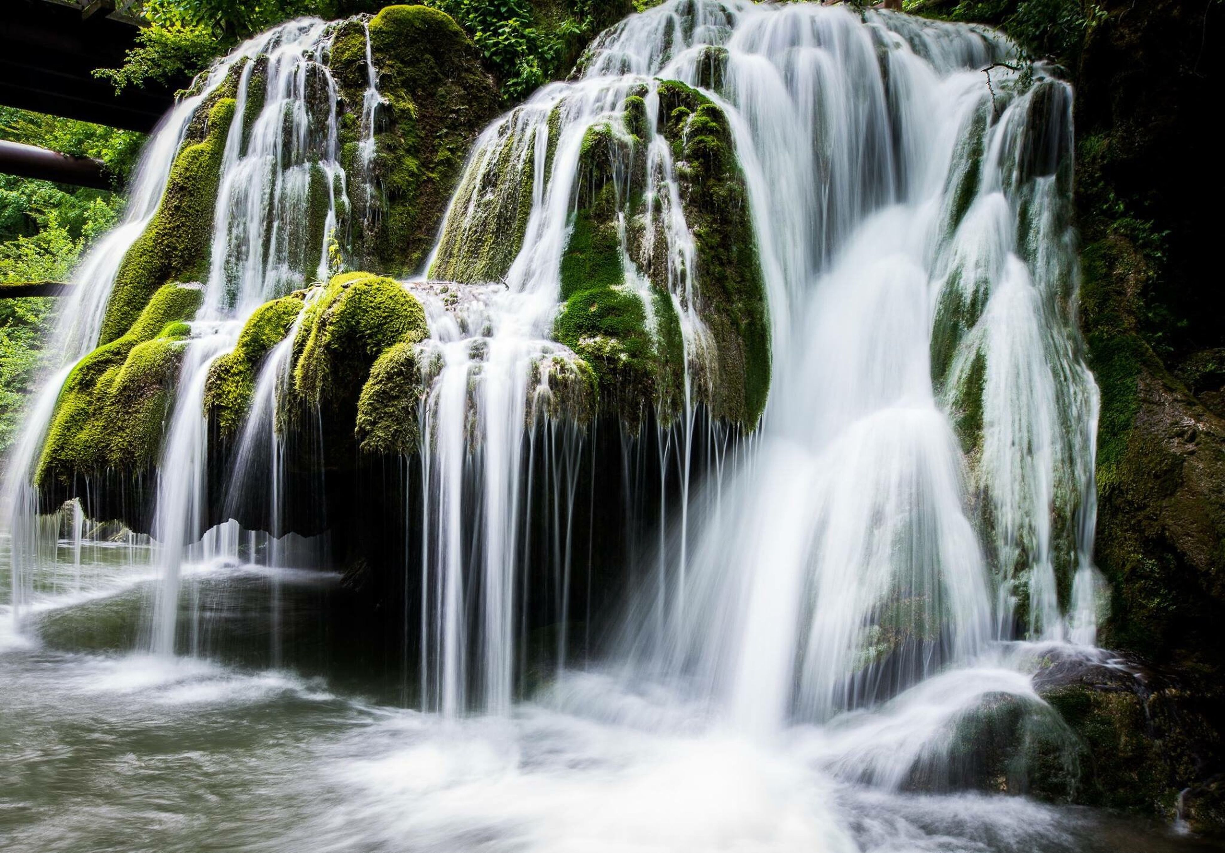 waterfall, water, motion, long exposure, scenics, beauty in nature, fountain, splashing, flowing water, nature, no people, flowing, idyllic, environmental conservation, tree, wet, stream - flowing water, running water, outdoors, freshness, sprinkling, day