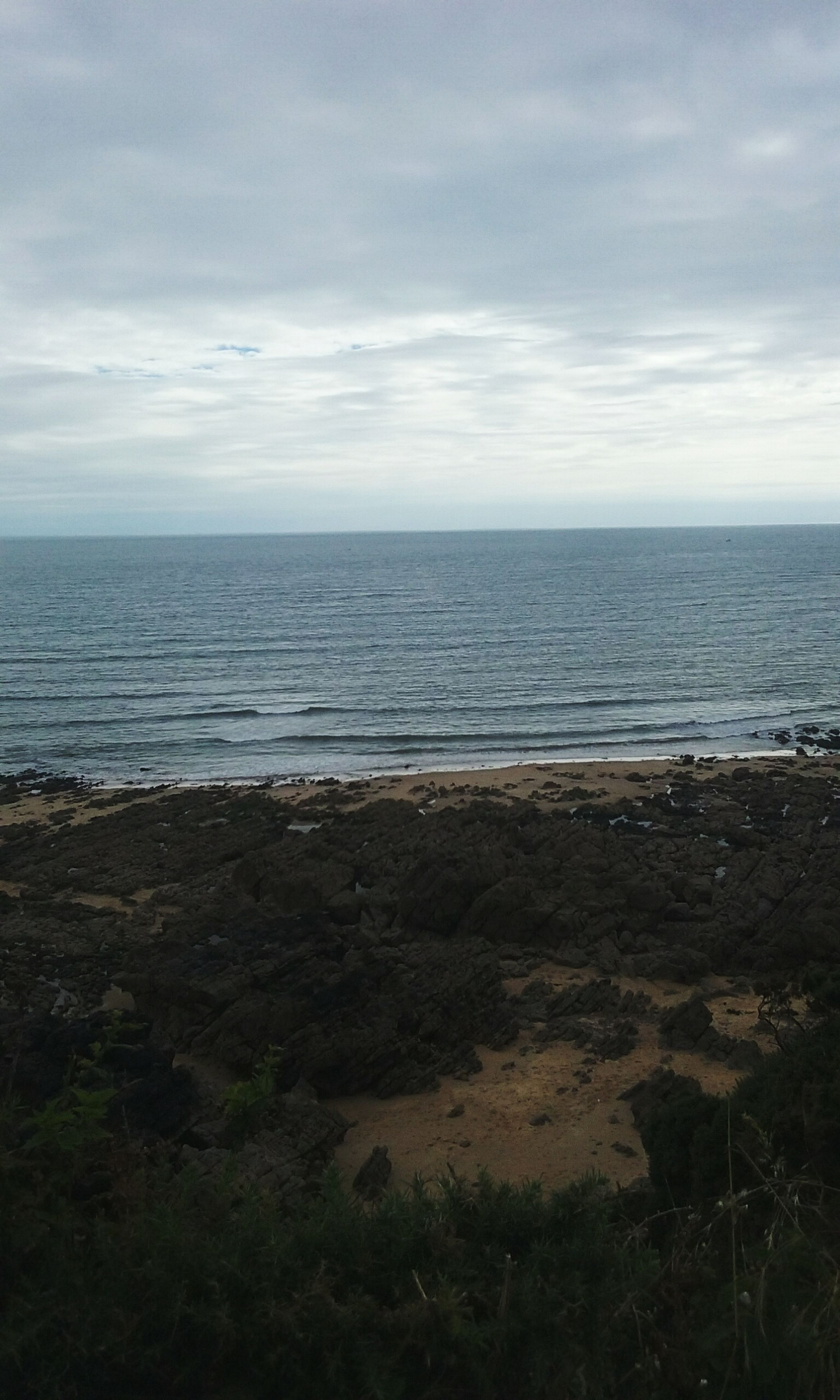 sea, horizon over water, water, sky, beach, tranquil scene, tranquility, scenics, beauty in nature, shore, cloud - sky, nature, idyllic, cloud, coastline, cloudy, remote, calm, day, outdoors, seascape, non-urban scene, no people, ocean, non urban scene, blue