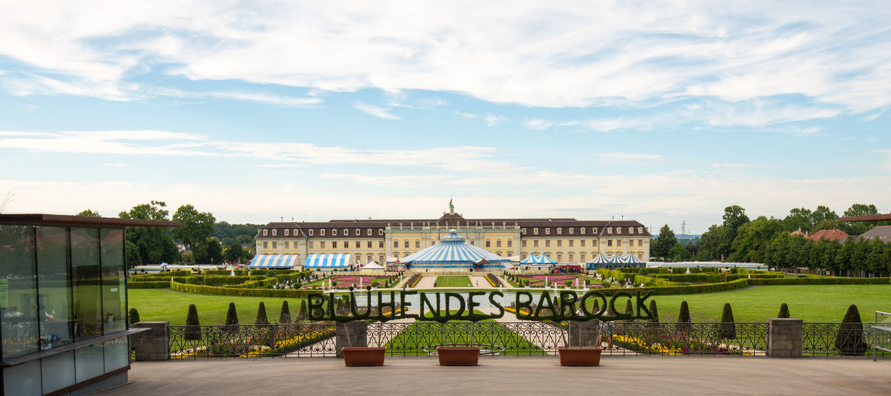 Ostfildern, Germany - July 30, 2016: The Ludwigsburg Palace (Schloss Ludwigsburg) in Baden Wuerttemberg, Germany with its lavish flower decoration called Flowering Baroque (Bluehendes Barock) is hosting the well-known Circus Roncalli in front of its facade. Architecture Baroque Baroque Architecture Blühendes Barock Circus Façade Flowers Garden Grass Ludwigsburg Ludwigsburgpalace Nature Outdoors Palace Plant Roncalli Tourism Travel Destinations