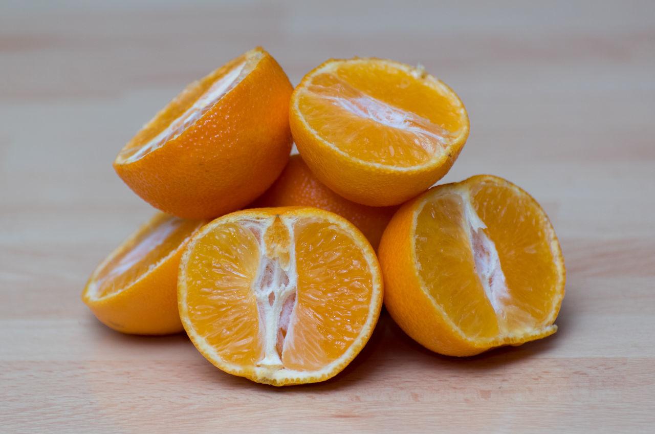 Blood Orange Citrus Fruit Close-up Cross Section Day Food Food And Drink Freshness Fruit Grapefruit Gray Background Halved Healthy Eating Indoors  Juicy No People Orange - Fruit SLICE Sour Taste Squeezing Studio Shot