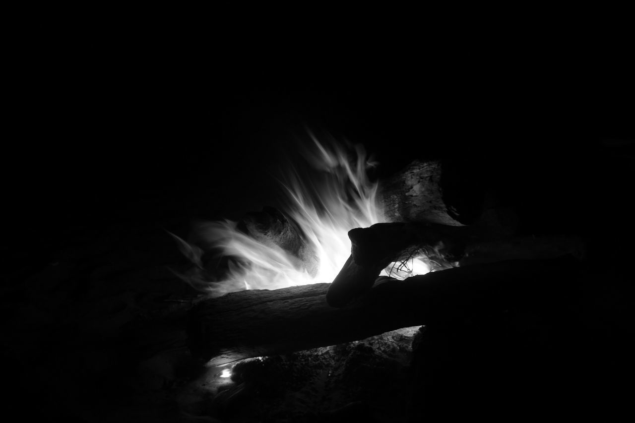 one person, dark, burning, night, heat - temperature, real people, indoors, close-up, people