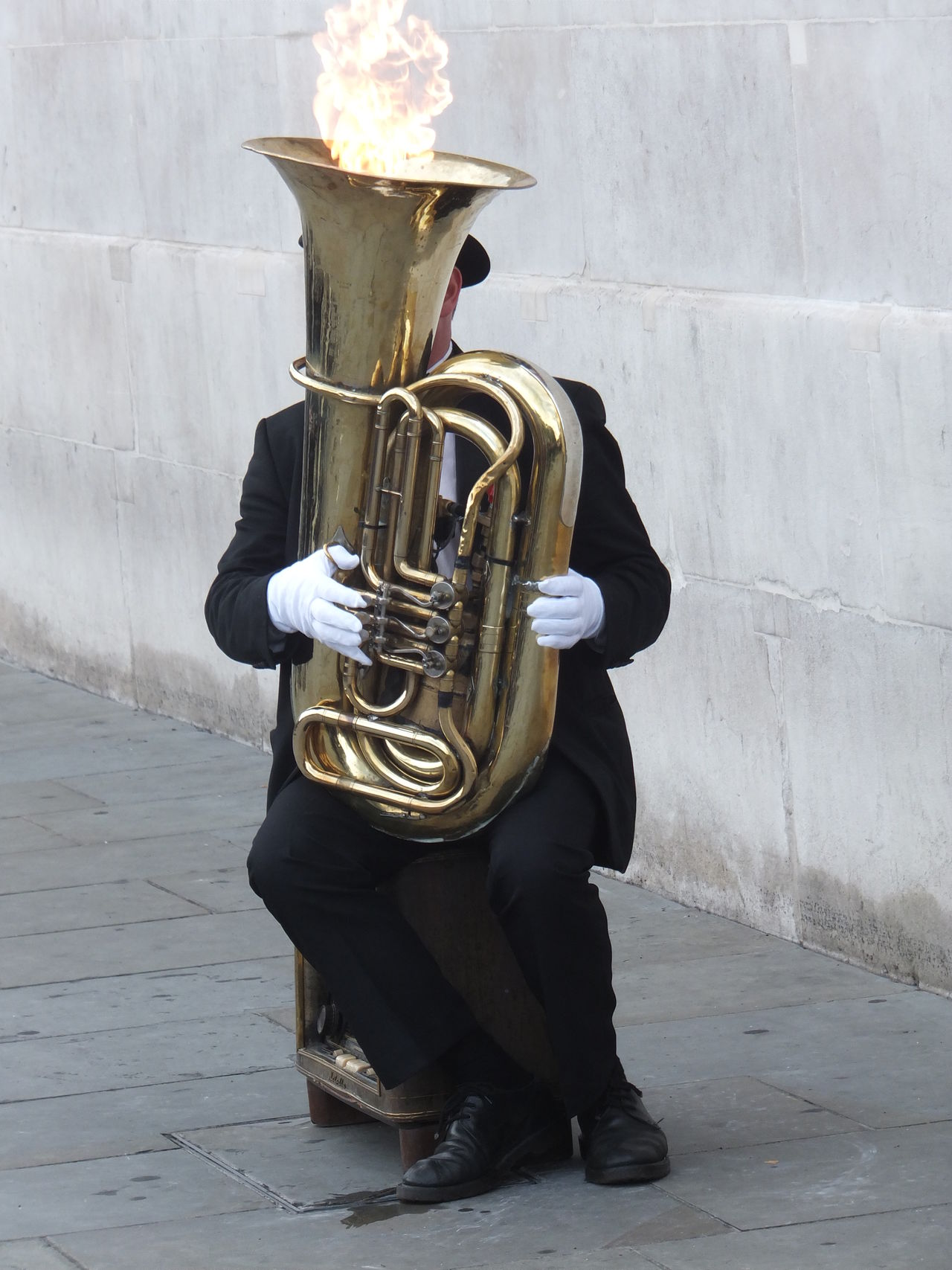 On Fire! Arts Culture And Entertainment Composition Fire Flames Full Frame Full Length Fun GB London Man Music Musical Instrument Musician On Fire One Person Outdoor Photography Performance Performer  Playing Sitting Street Performer Uk Unusual Wind Instrument
