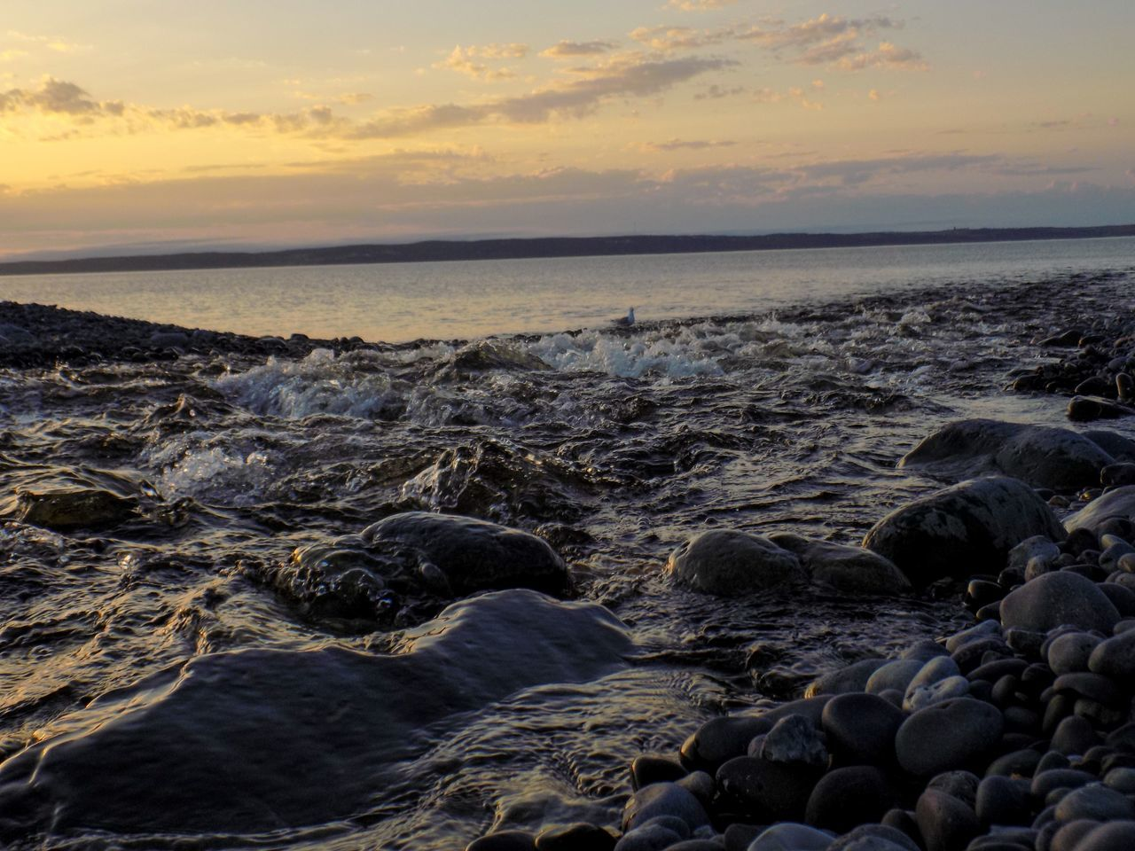 sea, beauty in nature, nature, sunset, water, beach, shore, scenics, tranquil scene, horizon over water, tranquility, no people, sky, pebble, outdoors, pebble beach, cloud - sky, wave, day