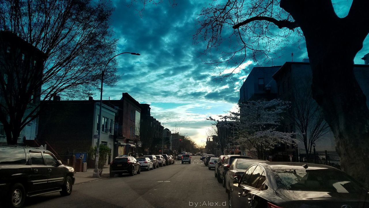 building exterior, architecture, car, built structure, land vehicle, city, sky, transportation, street, cloud - sky, mode of transport, outdoors, no people, road, tree, bare tree, day