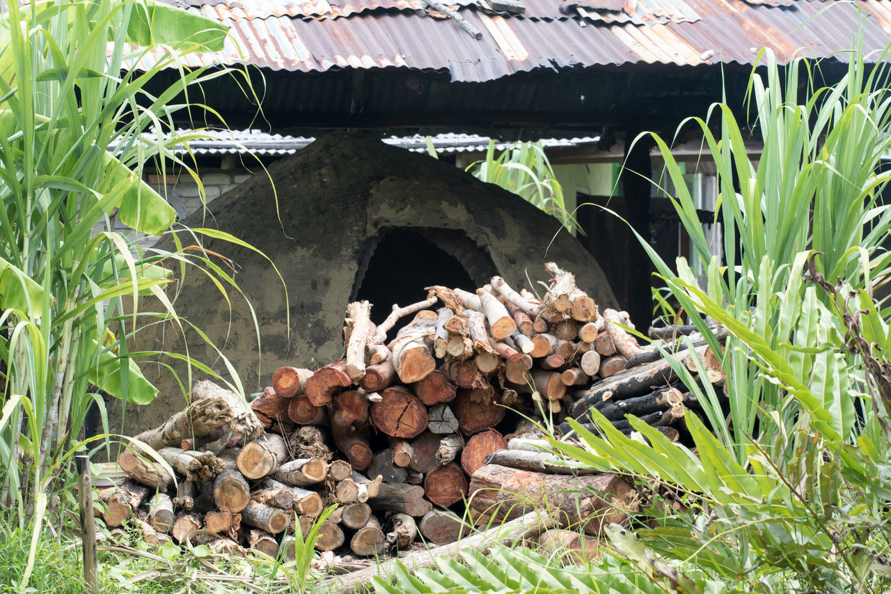 Kiln where wood charcoal are produced using traditional method. Charcoal Manufacturing Fireplace Firewood Kiln Large Group Of Objects Rural Scene