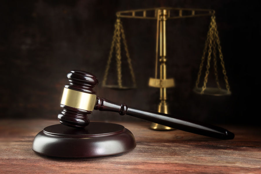 Judge gavel and scales on a wooden desk, symbol for balance and power in law and court, dark background with copy space Court Dark Desk Rustic Balance Concept Courtroom Day Gavel Indoors  Judge Justice - Concept Law Legal System Legal Trial No People Scales Symbol Wood - Material Wooden