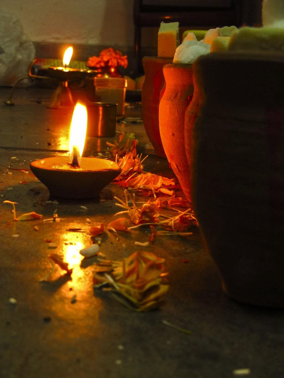 flame, no people, night, selective focus, burning, illuminated, heat - temperature, close-up, celebration, indoors, leaf, diya - oil lamp