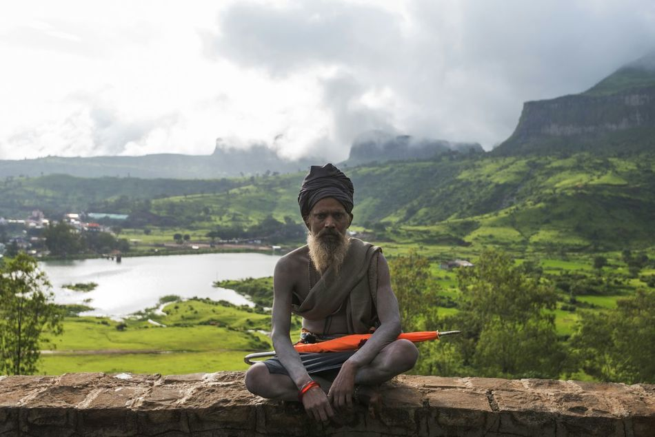 Picturing Individuality A saint resting while hicking up to bhramagiri peak to see the holy rive Godavari in Trimbakwshwar, India. Nashik Trimbakeshwar Saint Sadhu Umbrella Mountains Orange Showcase: December Enjoy The New Normal