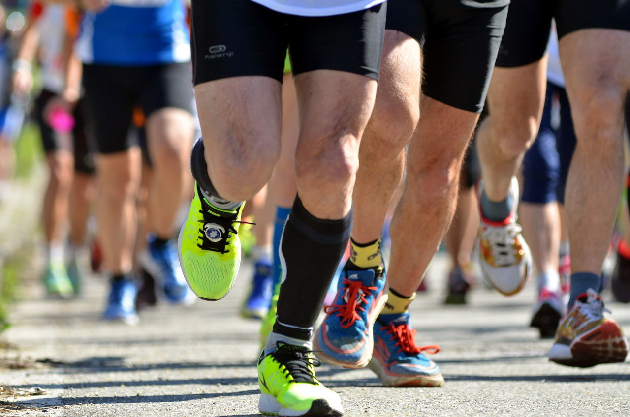 Marathon start Adult Athlete Competition Competitive Sport Human Body Part Human Leg Low Section Marathon Men People Shoe Sport Sports Event  Sports Race Sports Shoe Sportsman Starting Line Track And Field Athlete Young Adult
