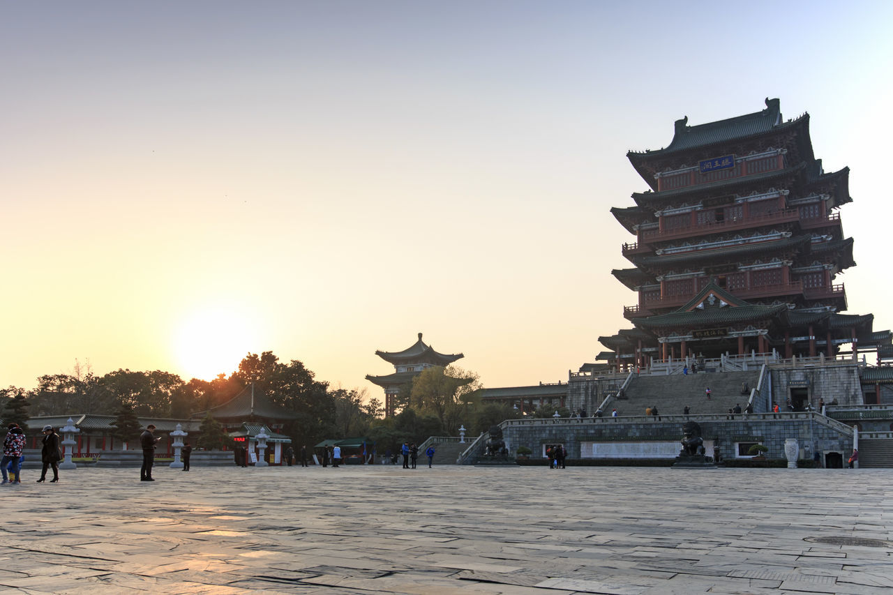 Nanchang, China - December 30, 2015: Tengwang Pavilion in Nanchang at sunset, one of the four famous towers in south China Architecture ASIA Built Structure China Chinese New Year City City Life Clear Sky Jianxi Lifestyles Metropolis Modern Building Nanchang Outdoors Pagoda Pavilion On Lake Province Sky Sun Sunlight Sunset Tengwang Tourism Tourist Travel Destinations