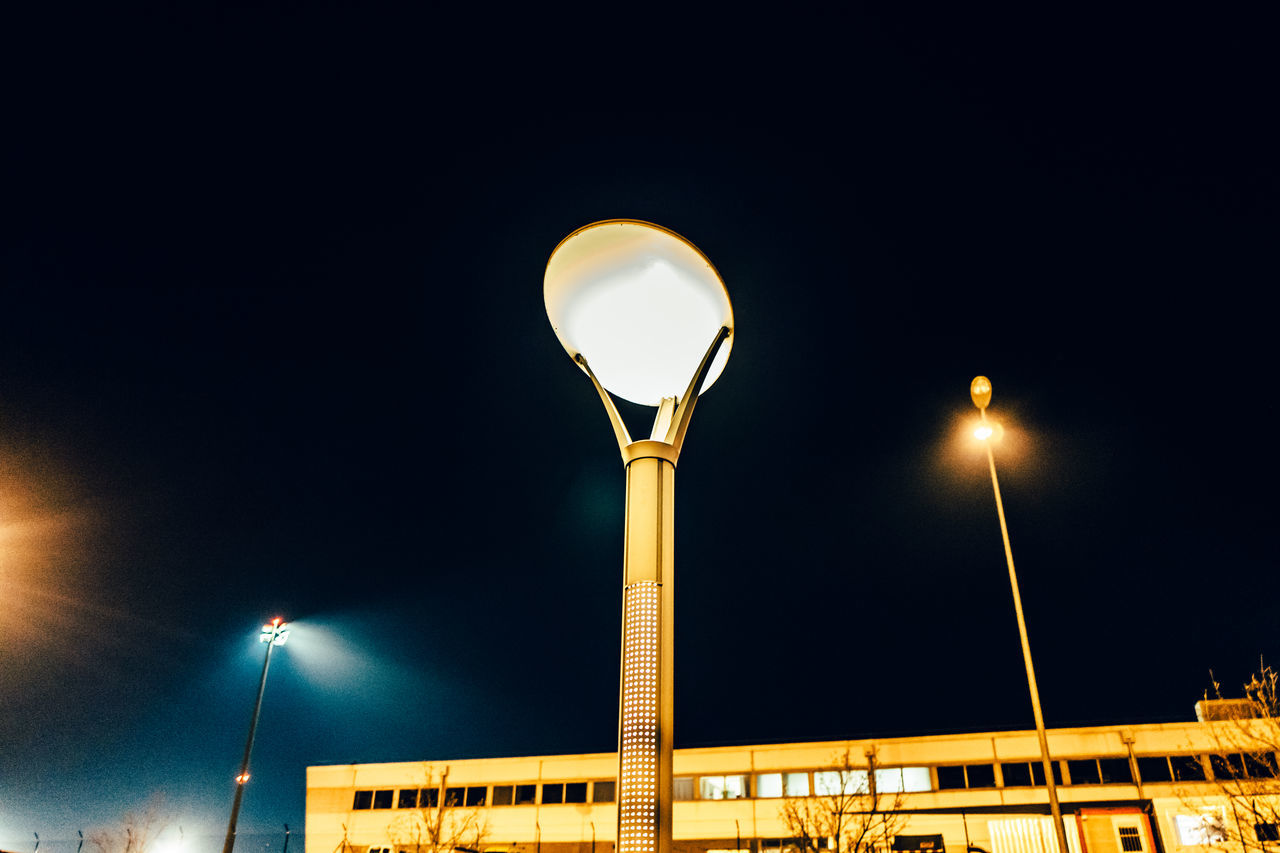 illuminated, street light, night, low angle view, lighting equipment, no people, architecture, built structure, outdoors, street lamp, floodlight, sky, clear sky, moon, building exterior