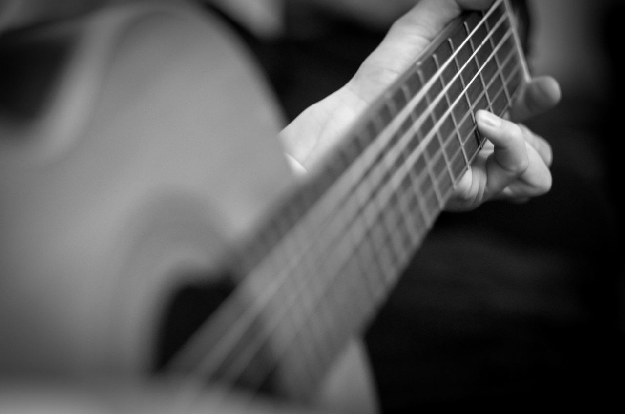 playing music / Blackandwhite Bnw Bnw_friday_eyeemchallenge Bokeh Close-up EyeEm Best Shots Finger Focus Focussed Fortheloveofblackandwhite Guitar Guitarist Hand Handmade Hands Hands At Work Human Body Part Human Hand Music Musical Instrument Musical Instrument String One Person Plucking An Instrument Real People Woodwind Instrument