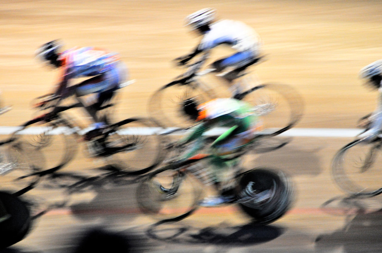 Bicycles Blurred Motion Blurry Competition Competitions Contest Cycle Race Cycle Racing Cycling Sport Cycling Track Group Of People Match Motion Motion Blur Movement Race Racing Racing Bicycles Speed Sports Sports Photography Sprinting Velodrome Showing Imperfection Need For Speed