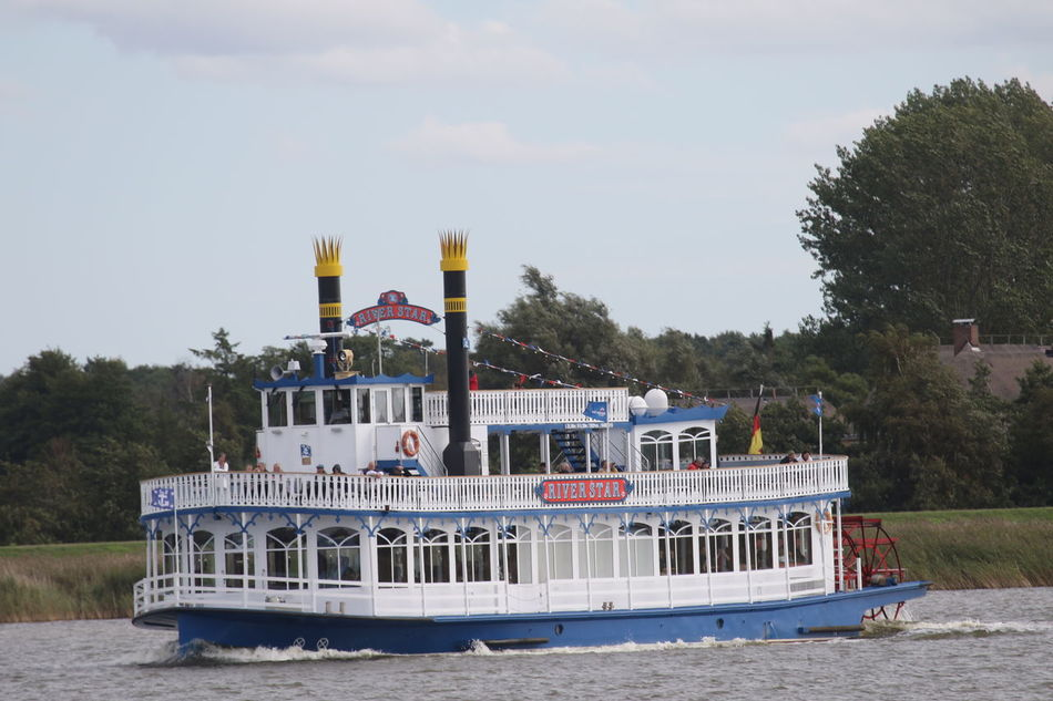 Day Leisure Activity Nautical Vessel Outdoors Paddle Wheel Steamer Real People Transportation Vacations Water Waterfront