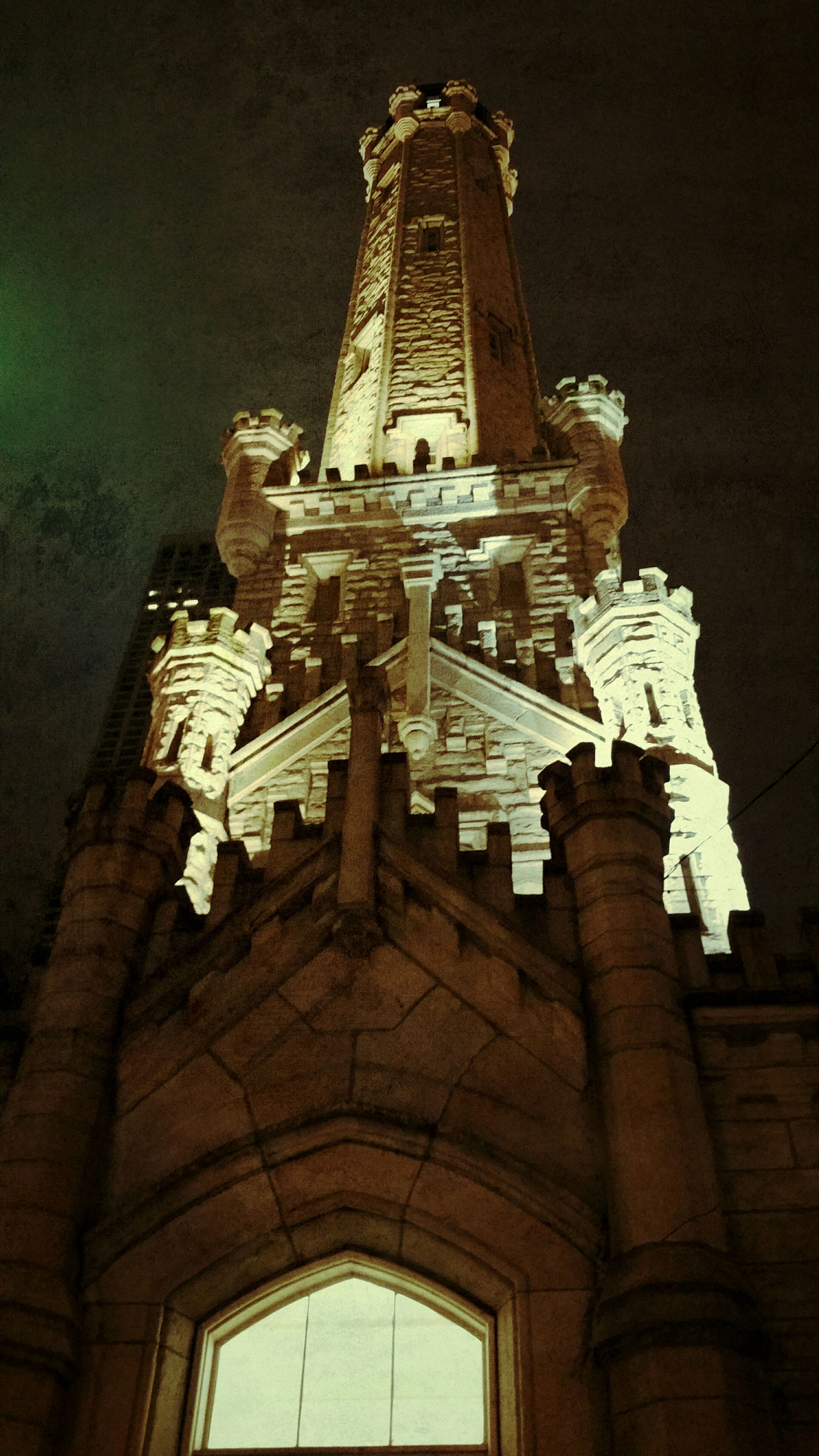 religion, place of worship, spirituality, architecture, church, low angle view, built structure, building exterior, cathedral, famous place, night, travel destinations, tourism, history, cross, illuminated, temple - building, no people
