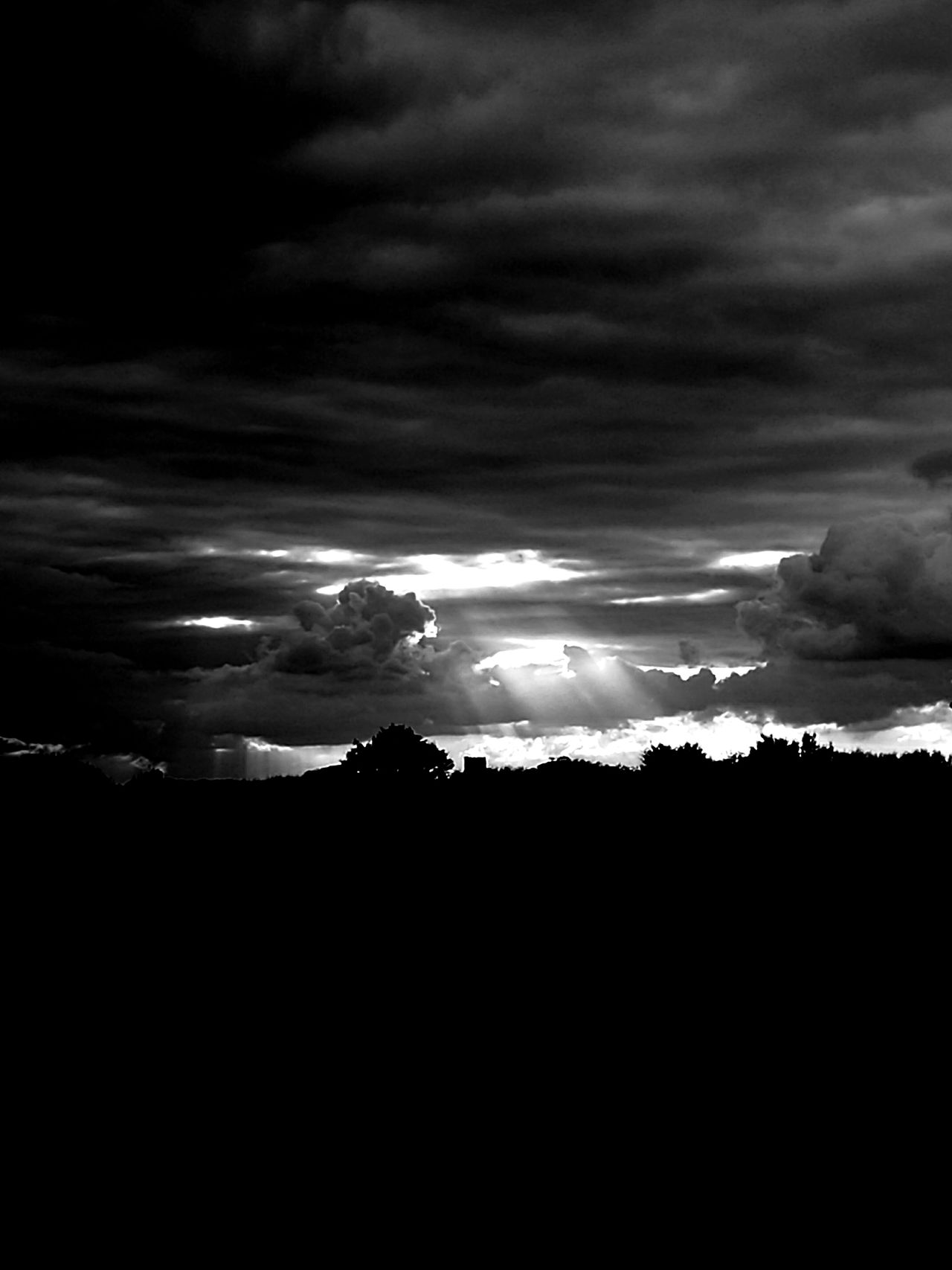 With the Sunlight streaming onto the Church...Monochrome Photography Silhouette Cloudy Storm Cloud Calm Outline Church Sunset