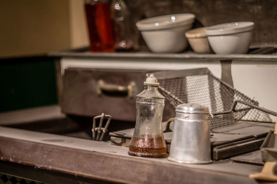 Antique Art And Craft Bottle Chip Chip Shop Chippy Close-up Container Focus On Foreground Glass - Material Home Interior Indoors  Metal Metallic No People Old Old-fashioned Salt Salt And Vinegar Salt And Vinegar Chips Selective Focus Shelf Still Life Table Vinegar