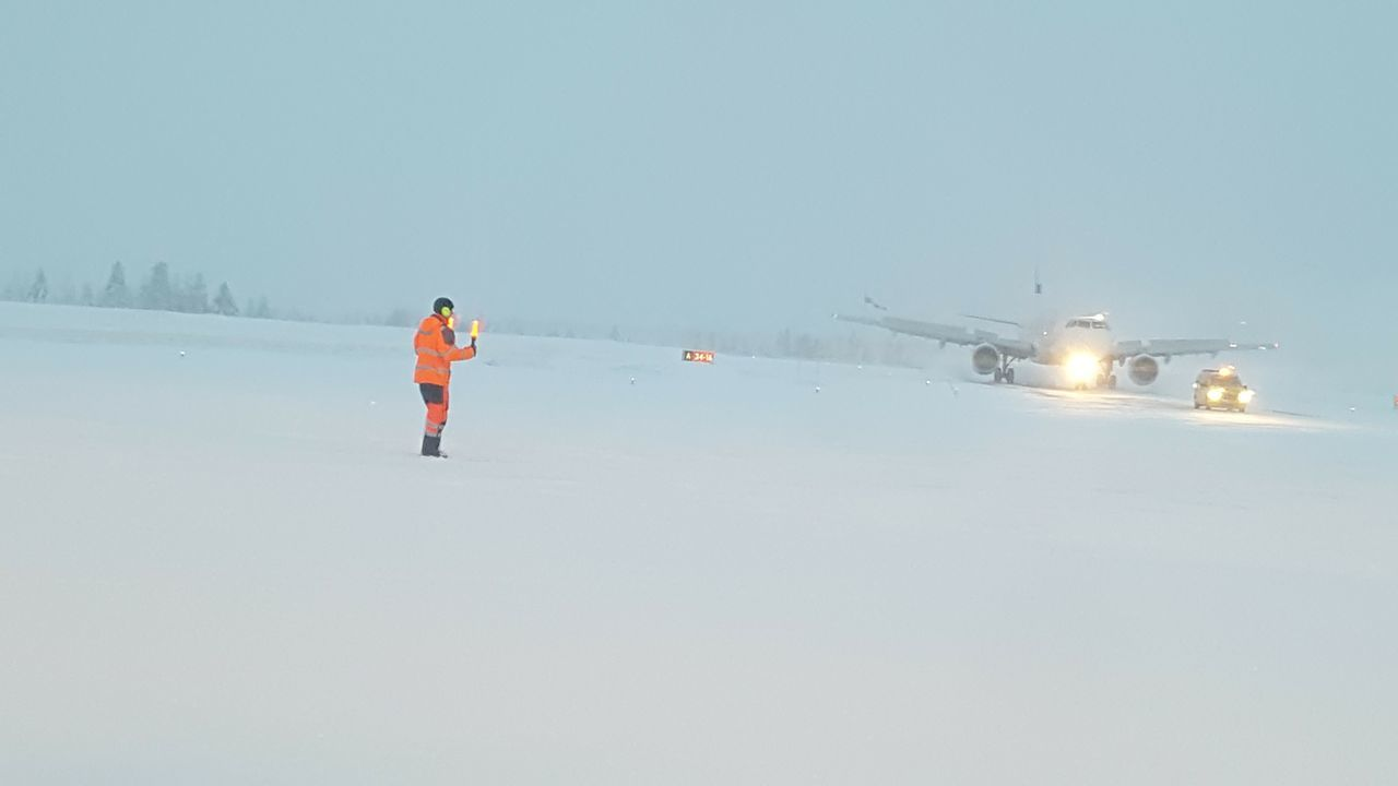 Snow Winter Cold Temperature Outdoors Full Length One Person Sky Adults Only People Day Winter Sport Adult Nature Young Adult Snowstorm Extreme Weather Winter Frozen Airport Runway Airportphotography Controller