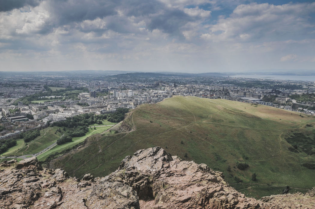 View on the Edinburgh skyline from Arthur's Seat Aerial View Arthur's Seat City Cityscape Cloud - Sky Day Enjoying Life Great Britain Landscape Mountain Nature Nature No People Outdoors Scenics Scotland Scotland Highlands Sky Travel Travel Destinations Travel Lover Urban Skyline