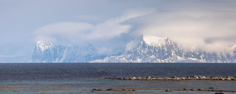 Beach Beauty In Nature Cloud - Sky Cold Temperature Day Dramatic Sky Idyllic Landscape Mountain Mountain Peak Mountain Range No People Norway Outdoors Panoramic Scenics Sea Sky Snow Storm Vacations Vesterålen Water Weather Winter