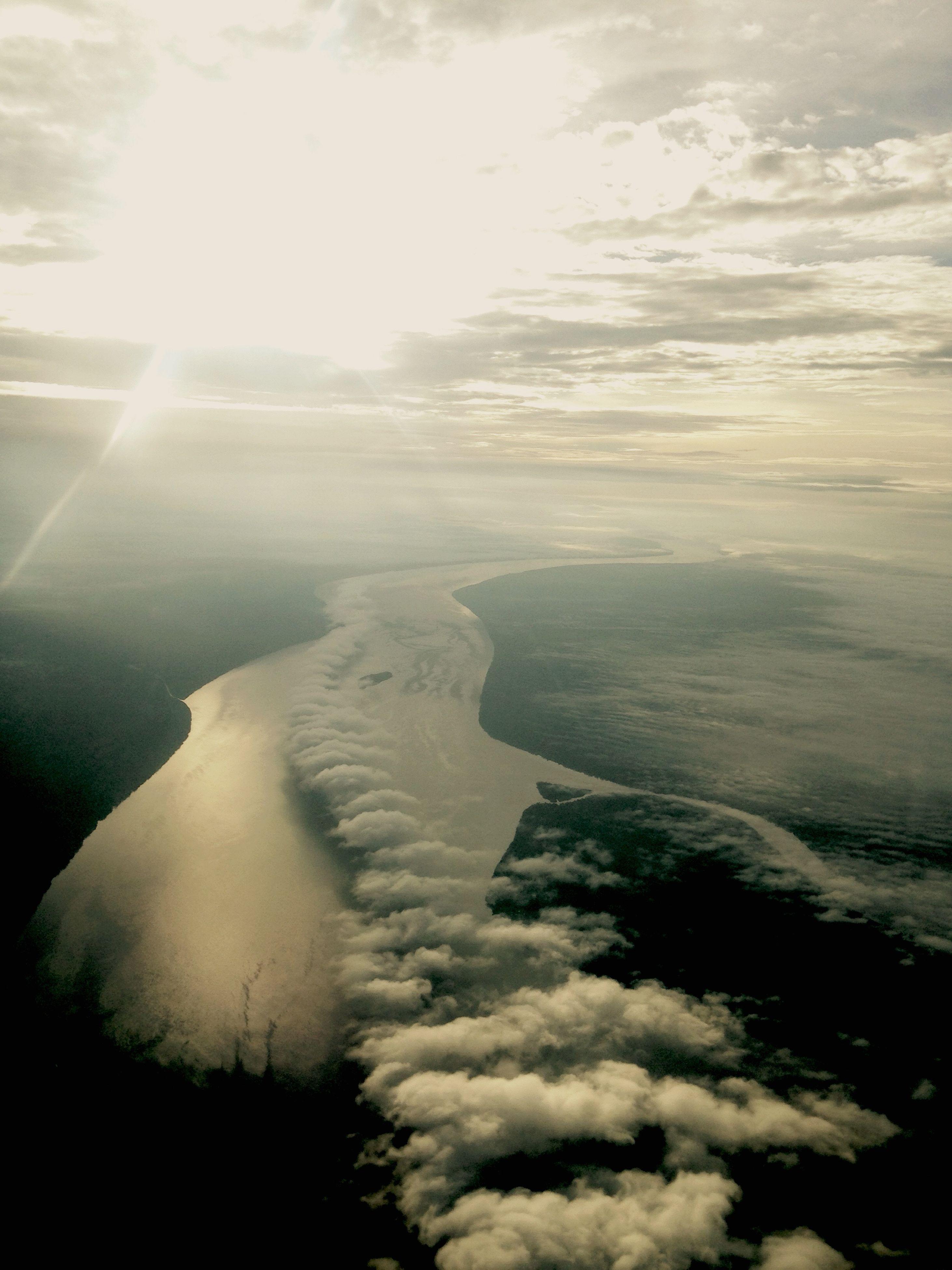 sun, scenics, sunbeam, tranquil scene, tranquility, beauty in nature, sky, sunlight, nature, landscape, lens flare, aerial view, mountain, cloud - sky, idyllic, mountain range, day, non-urban scene, outdoors, cloud