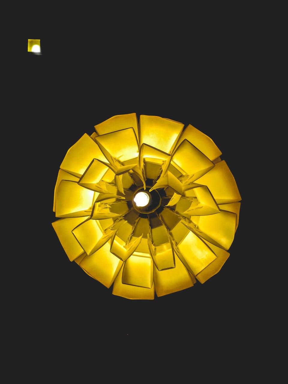 yellow, black background, illuminated, circle, night, gold colored, no people, studio shot, indoors, close-up