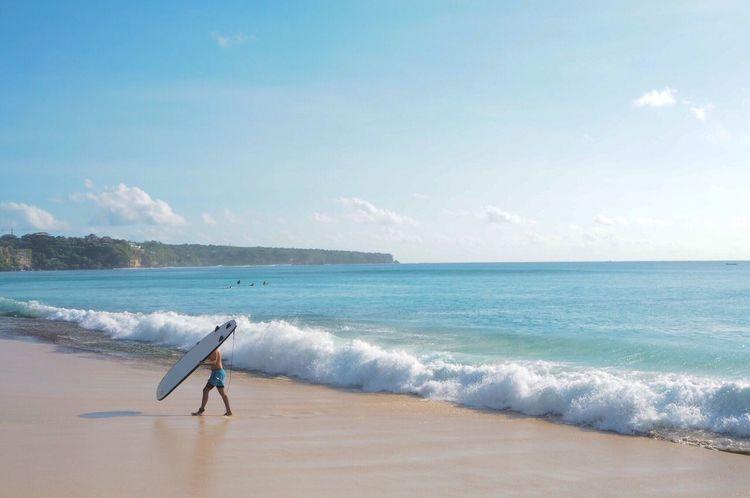 Sea Full Length Beach Water Wave Horizon Over Water Surfboard Sky Shore Surf Surfing Walking Side View Sport Motion Surfer Men Leisure Activity Water Sport Windsurfing Bali INDONESIA Travel Destinations Non-urban Scene Landscape