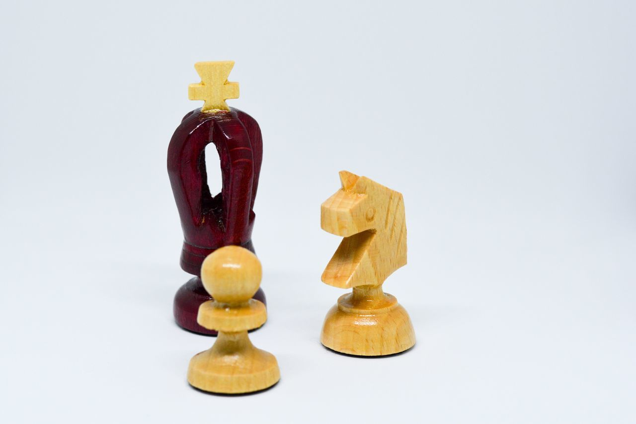 Chessmen Still Life Studio Shot White Background No People Close-up Figurine  White Black Chess Pawn King Knight  Wisdom Strategy Tactical War Battle Win Lose Play Game Wood Handmade Stark