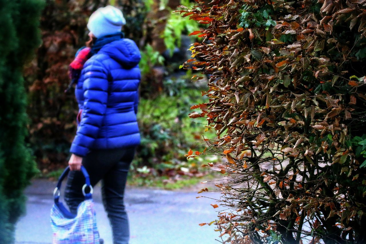 real people, rear view, nature, walking, tree, outdoors, leisure activity, day, focus on foreground, autumn, full length, childhood, plant, growth, standing, leaf, warm clothing, beauty in nature, freshness, people