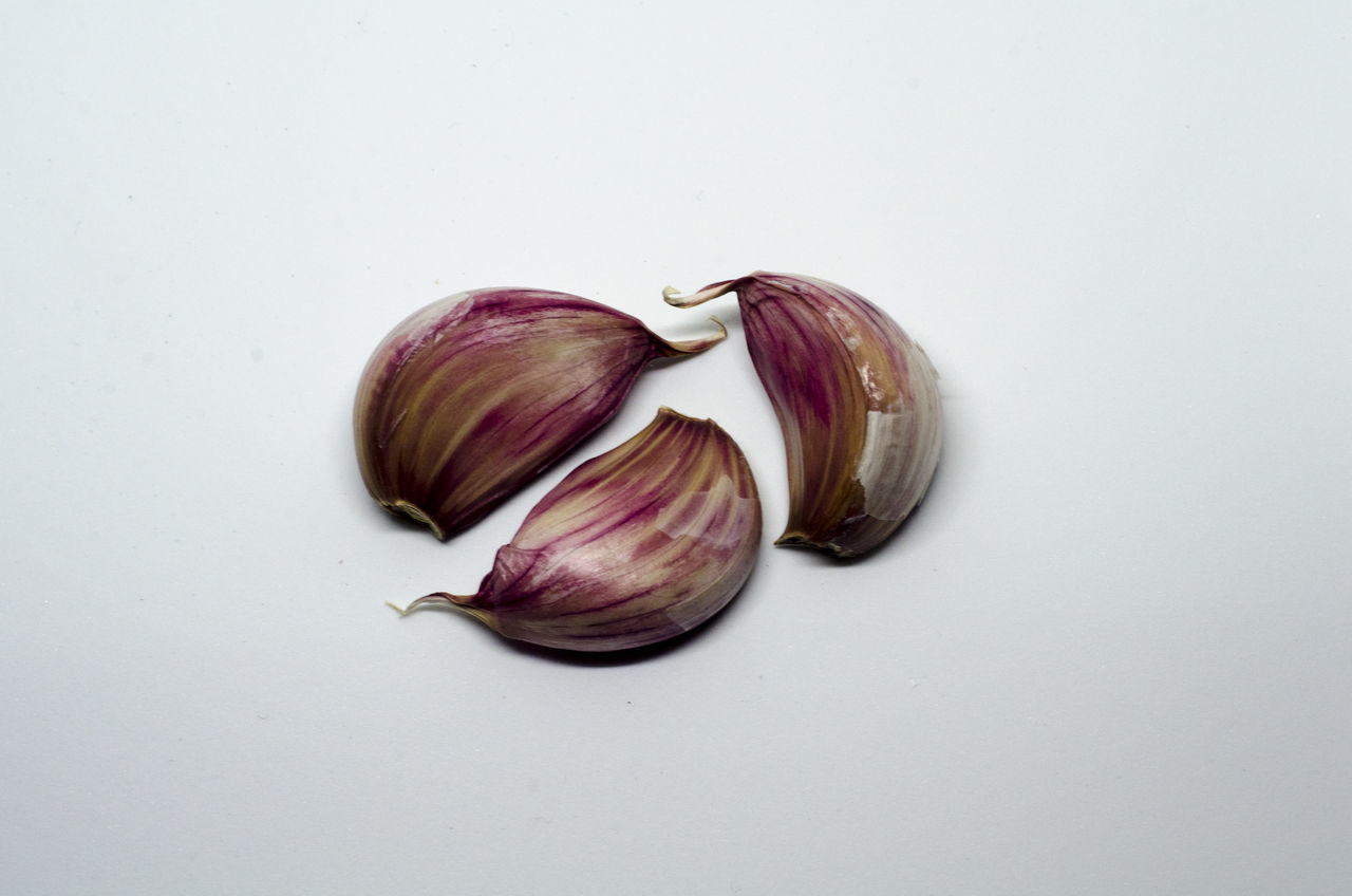 Three cloves of garlic Ajo Close-up Food Food And Drink Freshness Garlic Garlic Bulb Garlic Clove Healthy Eating No People Studio Shot White Background