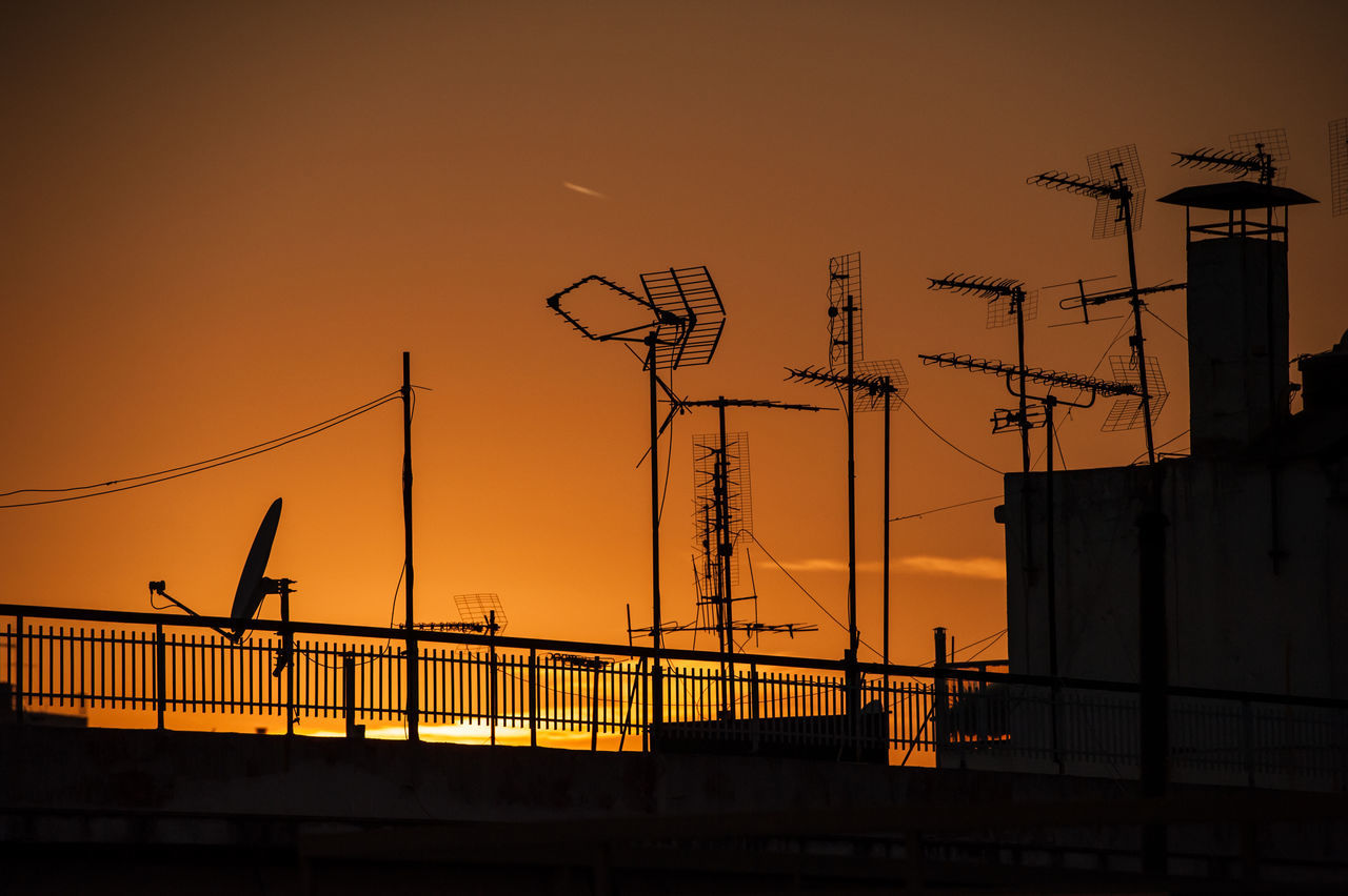 Antennas Architecture Building Exterior Business Finance And Industry Evening Night No People Orange Orange Color Orange Sky Outdoors Roof Rooftop Silhouette Sky Sunset