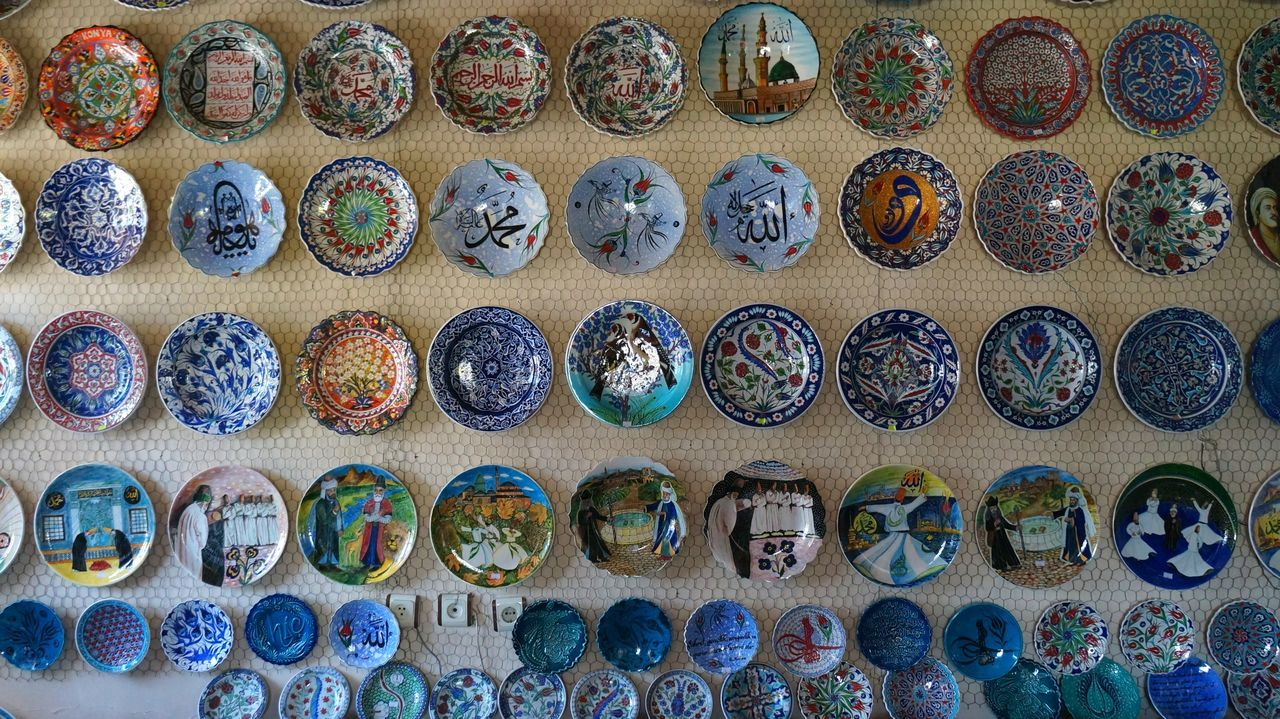 in a row, large group of objects, variation, multi colored, choice, abundance, neat, no people, indoors, beauty, day, eyeball