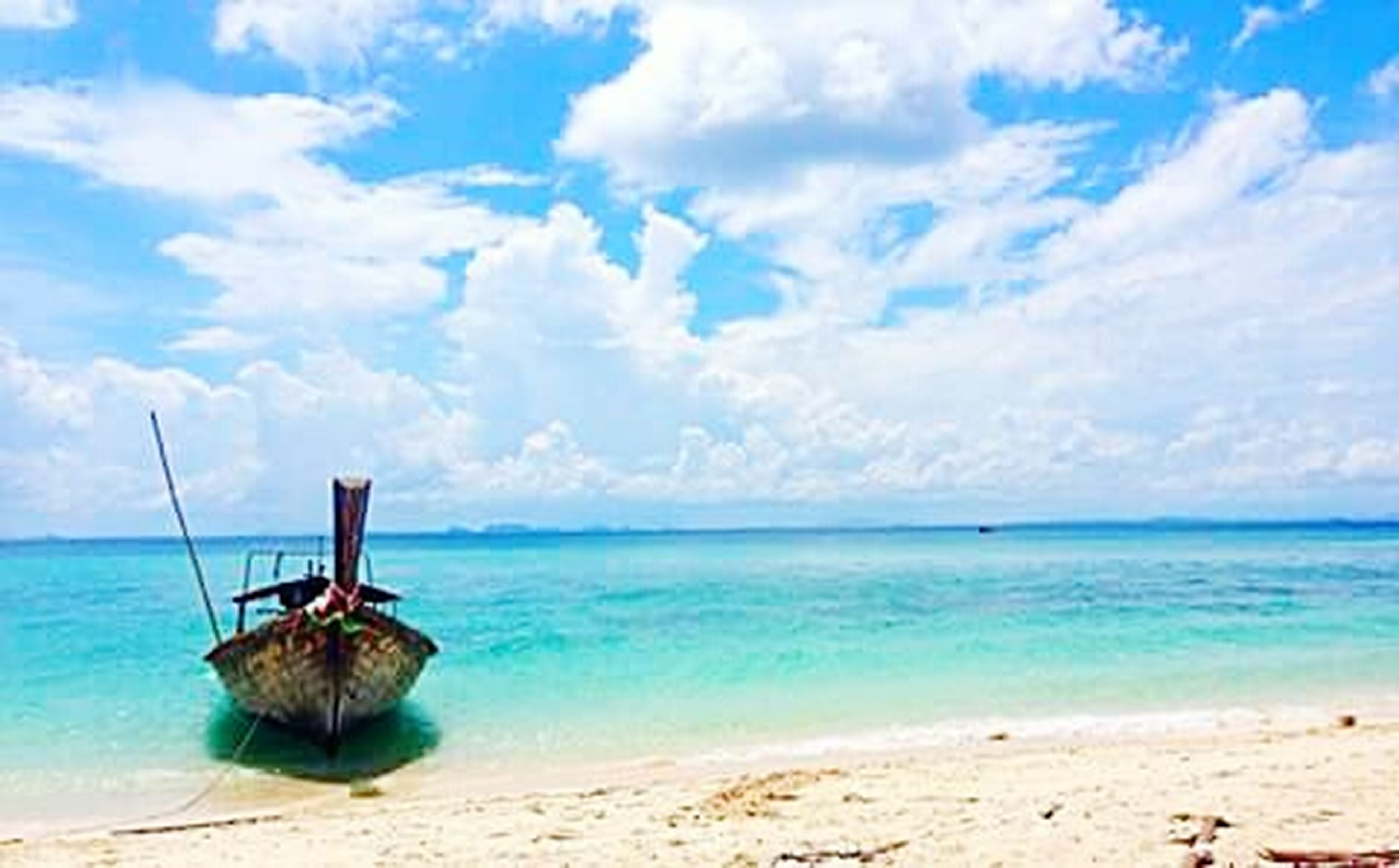sea, horizon over water, water, beach, sky, shore, tranquility, tranquil scene, scenics, sand, beauty in nature, blue, cloud - sky, nature, nautical vessel, cloud, idyllic, boat, day, calm