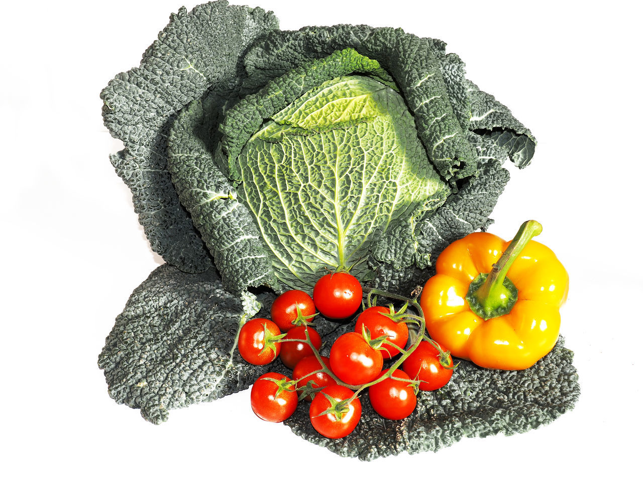 Tomatoes And Orange Bell Pepper With Savoy Cabbage Against White Background