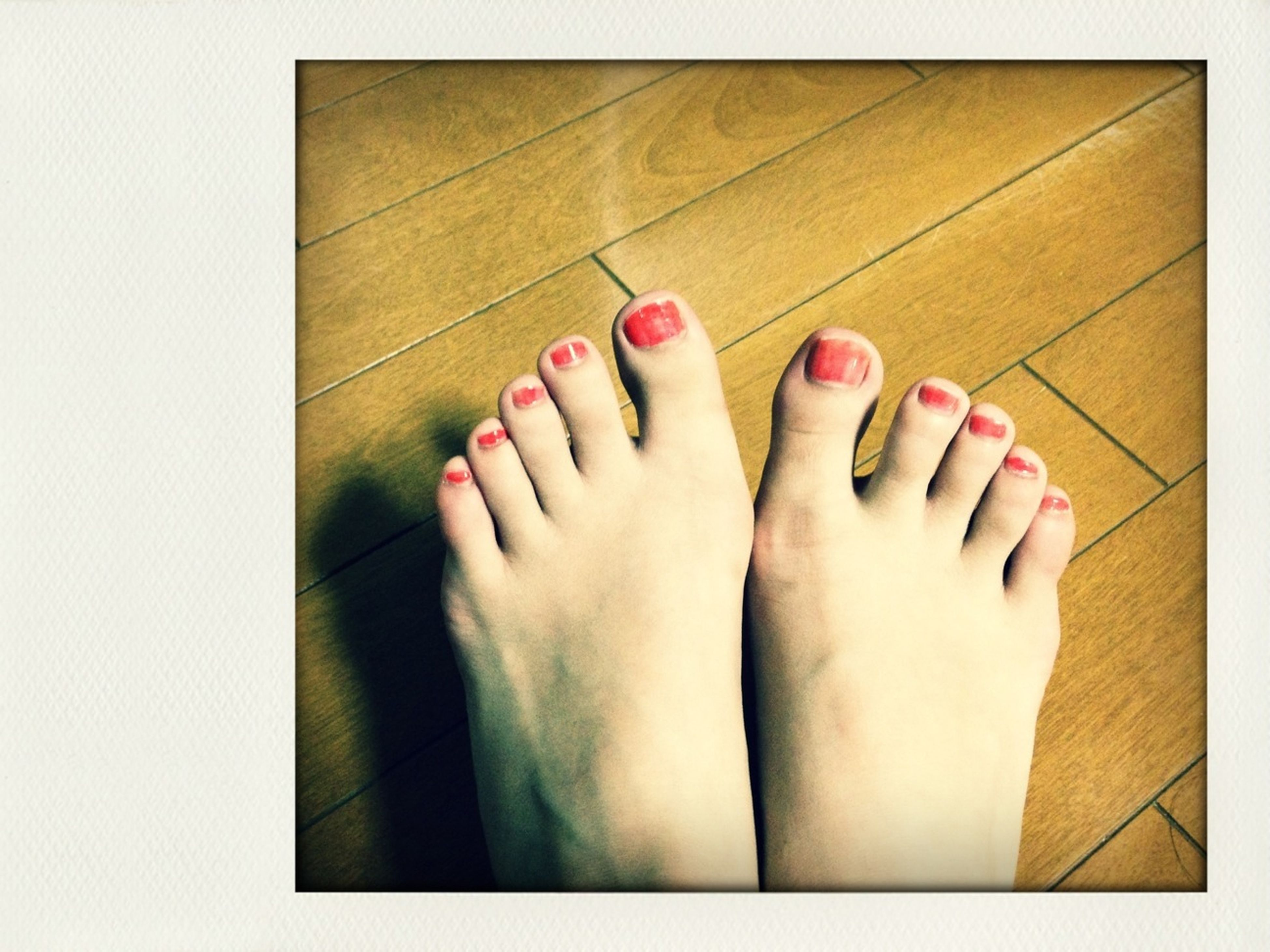 indoors, person, low section, personal perspective, part of, human foot, high angle view, lifestyles, human finger, close-up, barefoot, cropped, nail polish, leisure activity, flooring